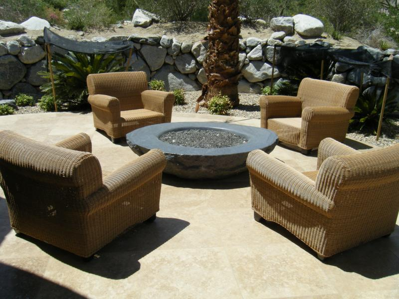 Black granite boulder fire pit